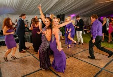 Sandy Brito and Leah Wampler, at center, dance together at the gala that raises money to fight Rett Syndrome. Photo by Doug Finger