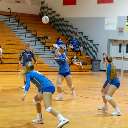 Local Sports: Marathon Volleyball Girls Head to District as 2 Seed - A group of people playing a game on the court - Basketball