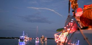Holiday Boat Parades You Don't Want to Miss - A group of people on a boat in the water - Boat parade