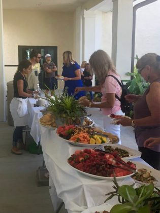 Teri Johnston is Officially Key West's Newest Mayor - A group of people sitting at a table with food - Buffet