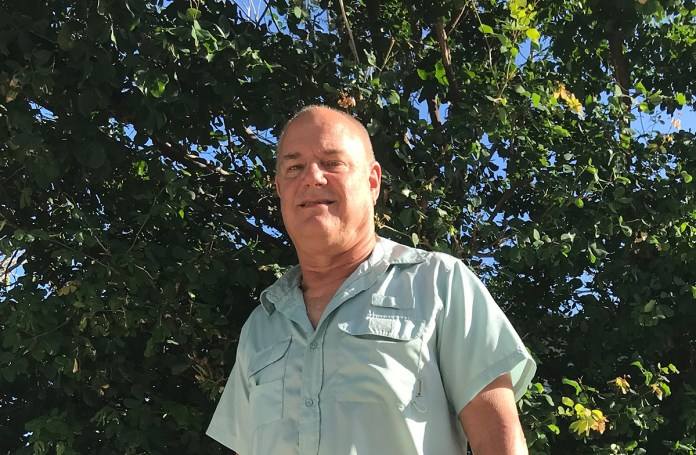 20 Questions With Chris Sante - A man standing in front of a forest - Islamorada