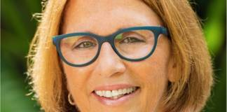 Teri Johnston Elected First Openly Gay Female Mayor of Key West - A woman wearing glasses and smiling at the camera - Teri Johnston