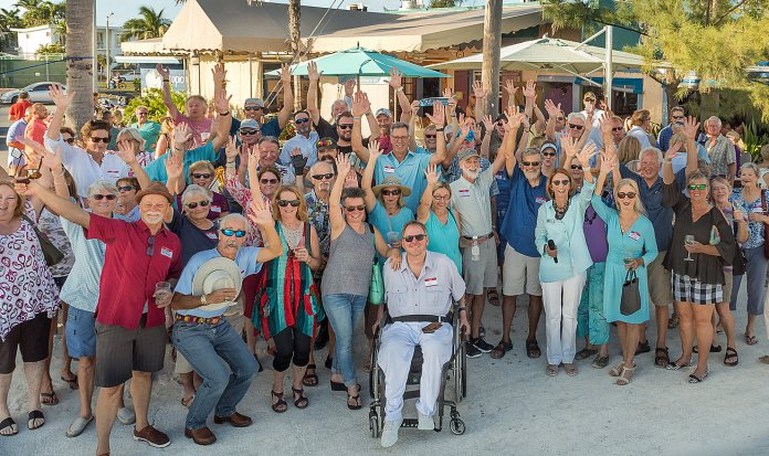 Key West is Isolated, but Exemplary - A group of people standing in front of a crowd posing for the camera - Teri Johnston