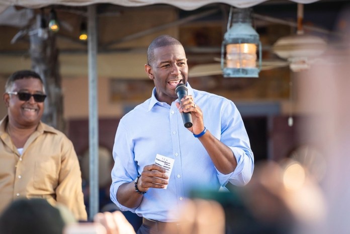 Florida Governor Hopeful Andrew Gillum Makes Final Push in Key West - Andrew Gillum talking on a cell phone - Public Relations