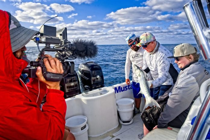 Local Marathon Anglers Featured on Syndicated Show - A group of people on a boat - Boat