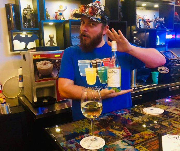 """""""Glitch"""" reimagines the bar game - A person sitting at a table with wine glasses - Glitchcraft"""