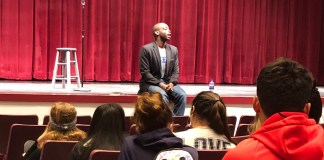 """From Here to """"Heaven"""": Rowan Ricardo Phillips visits Key West High School - A group of people standing in front of a curtain - Academic conference"""