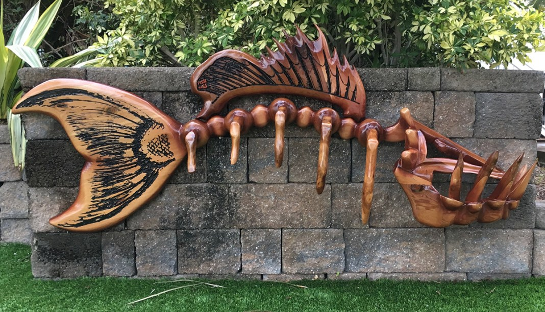 Mardi Gras Masquerade Ball aims to help hospital rebuilding efforts - A wooden bench sitting in the grass - Florida Keys Steak and Lobster House