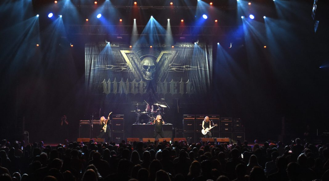 Vince Neil ready to rock the Keys - A large long train on a stage in front of a crowd - Rock concert