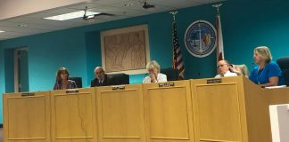 County Commission: Everything You Need to Know from Wednesday's BOCC Meeting - A group of people standing in a kitchen - Seminar