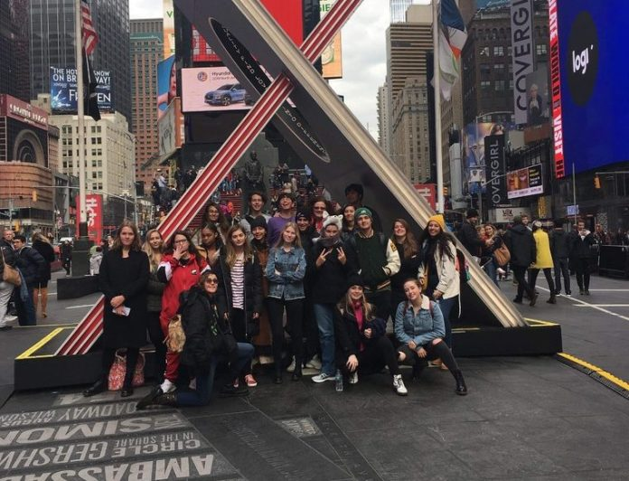 Coral Shores Students Take Over Broadway! - A group of people walking on a city street - Street