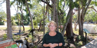 REEF director hits the ground running - A person standing next to a tree - Tree