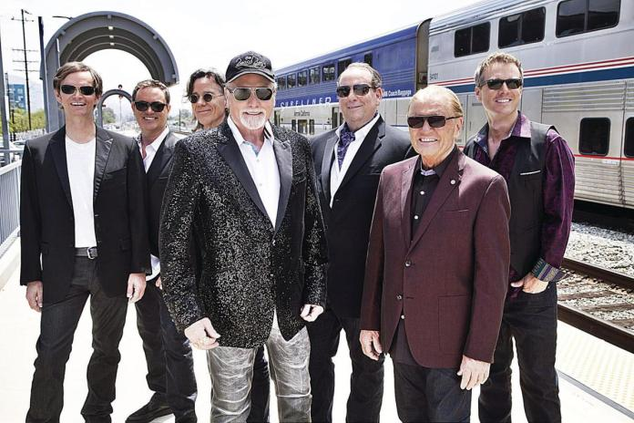 The Beach Boys come to Key West! - A group of people posing for the camera - Mike Love