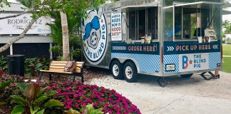 Food truck finds: Check out the Blind Pig - A truck is parked on the side of a flower - Food truck