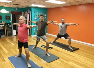 Males in Yoga increase in the Upper Keys - A group of people standing in a room - Yoga