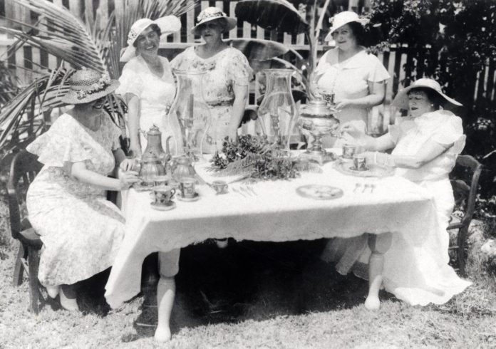 """From Hookers to High Society: David Sloan's """"Key Lime Pie Hole"""" - A group of people sitting around a table - Key lime pie"""