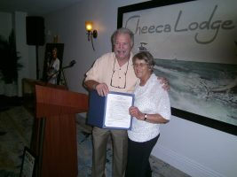 John Hazelbaker presenting award from Mayor Deb Gillis of Islamorada.