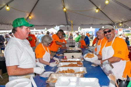 The plating assembly line includes Paul Lebo, left, president of the Organized Fishermen of Florida's Marathon chapter, and David May, right.