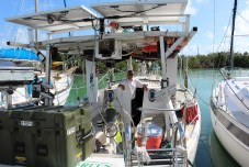 HIGH ADVENTURE - A boat is docked next to a body of water - Fishing vessel