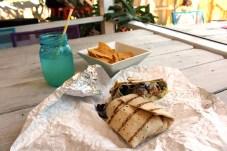 Keys Eats: Bad Boy Burrito - A sandwich sitting on top of a wooden table - Bad Boy Burrito