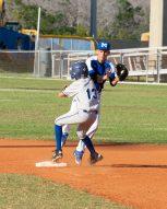 Marathon High baseball team begins season - A baseball player pitching a ball on a field - Baseball