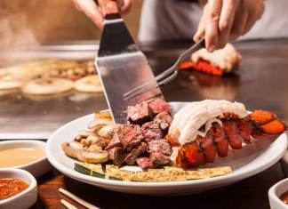 Key West's Benihana getting a makeover - A woman sitting at a table with a plate of food - Teppanyaki