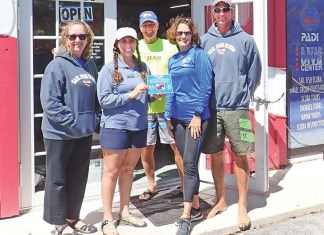 Blue Star adds diving, fishing operators - A group of people posing for the camera - Ultramarathon
