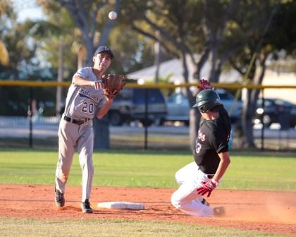 Palmer Trinity's second basemen Luis Carajal turns a double play.AUSTIN ARONSSON/Keys Weekly