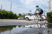 Claudia Stober sets out on her bike following a stop at Ocean Sotheby's International Realty in Islamorada on April 5.