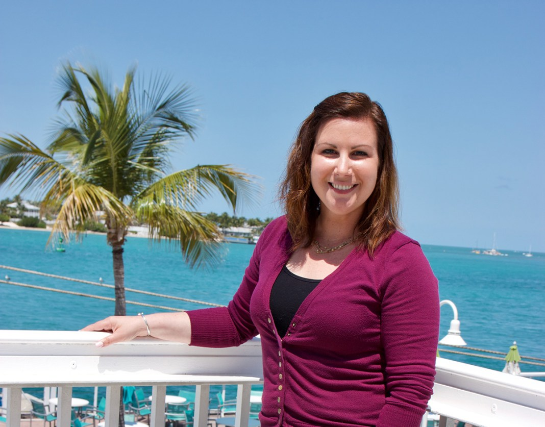 Jessica Long makes marketing look easy - A woman standing in front of a body of water - Jessica Long
