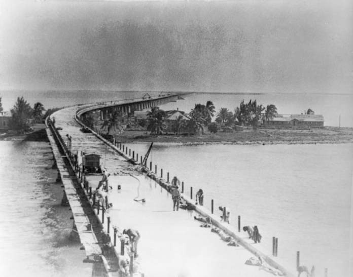 WIDENING THE BRIDGE  – Keys History - A vintage photo of a boat next to a body of water - Overseas Highway