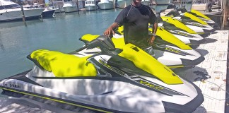 Big Kahuna Watersports offers customizable jet ski tours in Marathon - A man in a yellow boat in the water - Islamorada Boat & Jet Ski Rentals