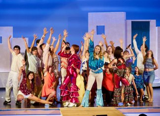 - A group of people posing for the camera - Mamma Mia!