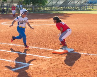 Lady Fin Monica Bueno beats it out to first base. BARRY GAUKEL/Keys Weekly