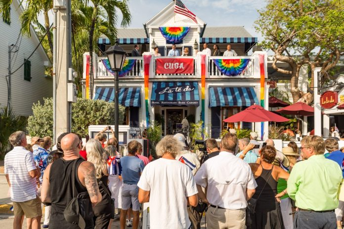 Get the Full Report on the Cuban Ambassador's Historic Visit to Key West - A group of people walking down a street - La Te Da