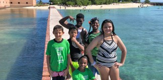Reef Relief camp adds 'Big Kids' - A woman standing next to a body of water - Reef Relief