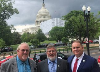 Keys representatives visit D.C. for funding - A man standing in front of a group of people posing for the camera - Luxury vehicle