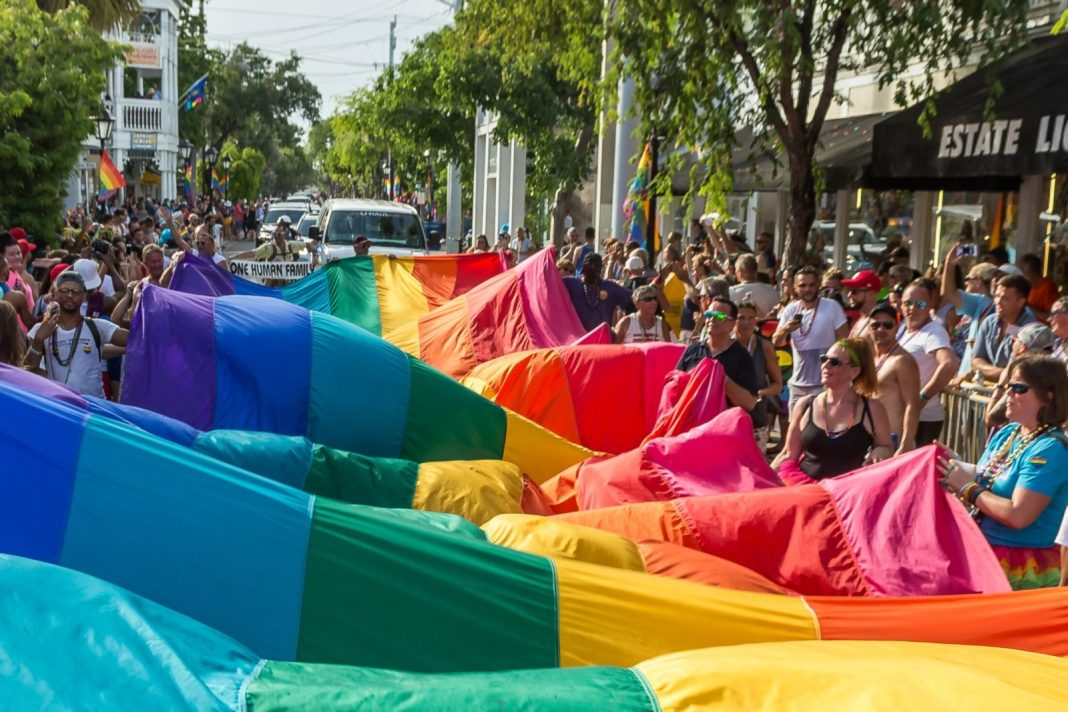 Rainbows in Forecast for Key West - A crowd of people watching a colorful blanket - Key West