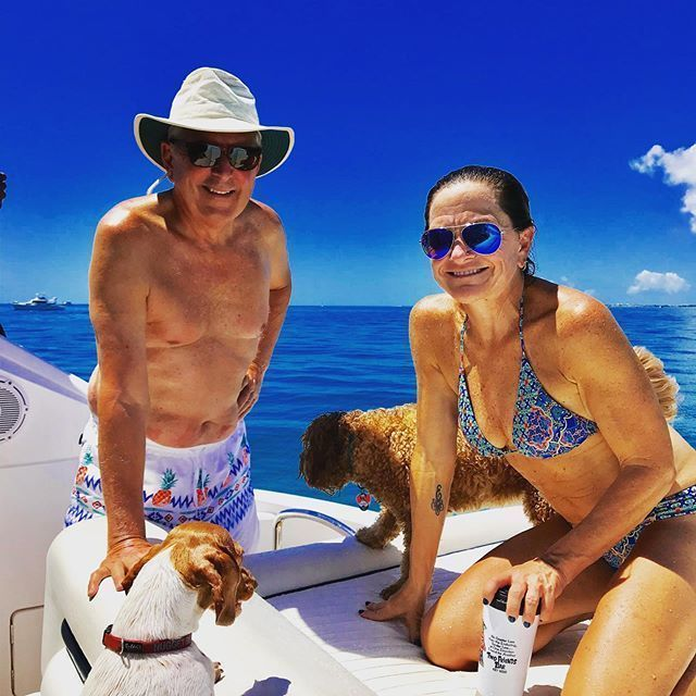 """Local Restaurant Owner Wins """"Chubbies 2019 Man Model Contest"""" – Two Friends' Danny Hughes Embarks on Modeling Career - A group of people sitting around a dog - Florida Keys"""