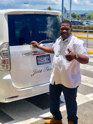 Jamaica in 24 Hours: An island adventure in a day - A man standing in front of a truck - Car
