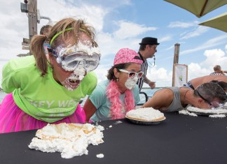 Key Lime Festival 2019 - A group of people sitting at a table eating food - Key West