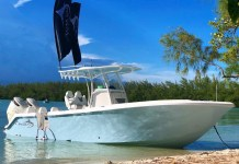 CUSTOM BOAT BUILDER - A boat sitting on top of a beach - Boat