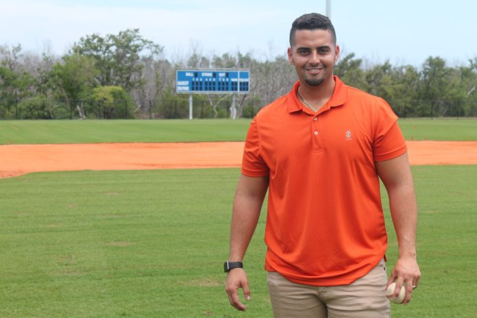 Gonzalez promoted to MHS varsity baseball coach - A man standing on a baseball field - Florida Keys