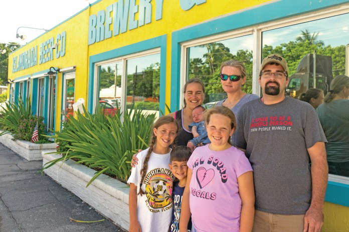 Middle Keys baby makes sudden appearance in unlikely spot - A group of people posing for the camera - Islamorada Beer Company