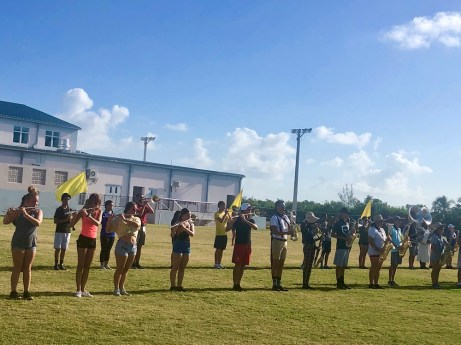 Putting the Band Back Together – KWHS Marching Band prepares for the field - A group of people standing on top of a grass covered field - KEY WEST HIGH SCHOOL