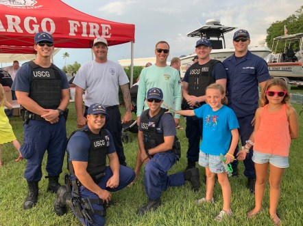 COMMUNITY PARTNERS – Family, food and fun with first responders - A group of people standing in front of a crowd posing for the camera - iT'Z