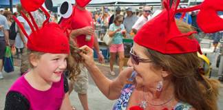A Crustacean Celebration – Key West Lobsterfest 2019 - A group of people wearing costumes - Duval Street