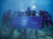 Coral Collaboration – Scientists, students and veterans join forces - A group of people swimming in the water - Florida Keys