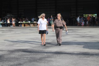 TOP COPS – National Night Out draws a crowd - A person is walking down the street - Florida Keys/Marathon International Airport