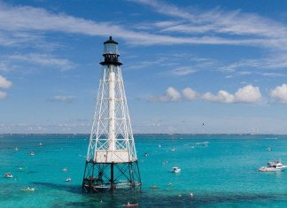 Alligator Lighthouse surrounded by blue water.